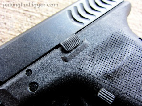 Pictured: Tango Down Vickers Tactical Glock Slide Stop for 9mm/.40SW Glocks.