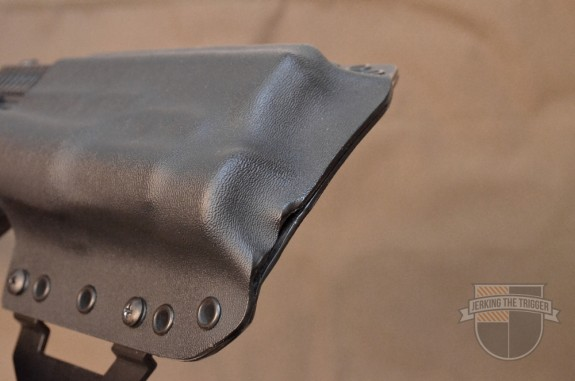This image shows the 90/10 mold. The majority of the gun's width is molded into the holster's front panel. It also shows the fit and finish issue mentioned earlier in the review.